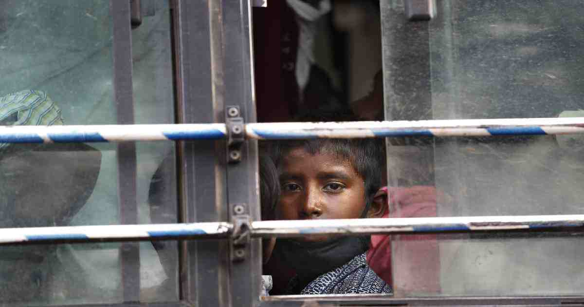 The son of a migrant daily wage laborer looks out a bus window bus as he travels to his hometown following a lockdown amid concern over spread of coronavirus in New Delhi, India, Friday, March 27, 2020. Some of India's legions of poor and others suddenly thrown out of work by a nationwide stay-at-home order began receiving aid on Thursday, as both public and private groups worked to blunt the impact of efforts to curb the coronavirus pandemic. The measures that went into effect Wednesday, the largest of their kind in the world, risk heaping further hardship on the quarter of the population who live below the poverty line and the 1.8 million who are homeless. (AP Photo/Manish Swarup)