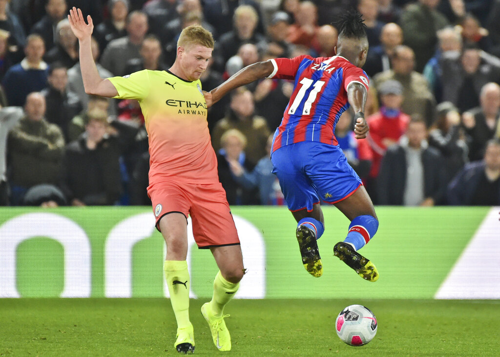 Man City beats Palace 2-0 to keep up pressure on Liverpool