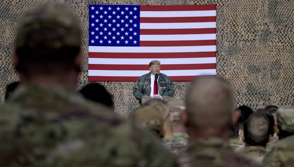 On visit to Iraq, President Trump defends withdrawal from Syria