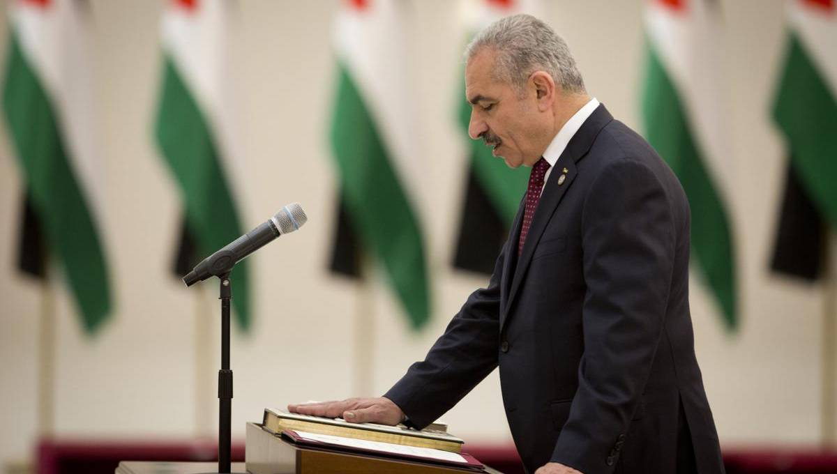 Palestinian president swears in new government