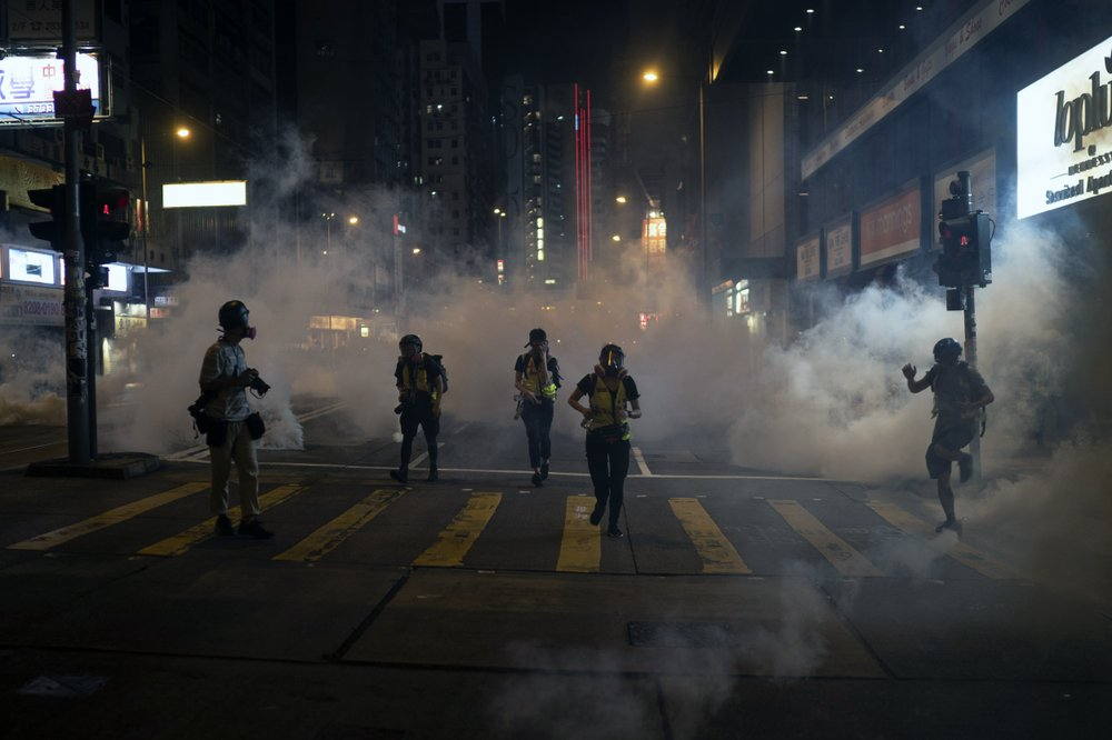 Hong Kong suspends trains, again rallies after 'dark day'