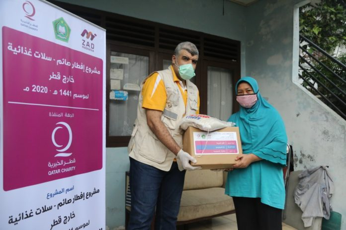Qatar Charity distributes food packages for Indonesians affected by COVID-19