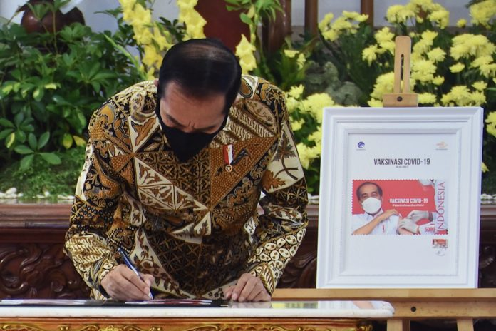 Indonesian president launches COVID-19 vaccination serial stamp