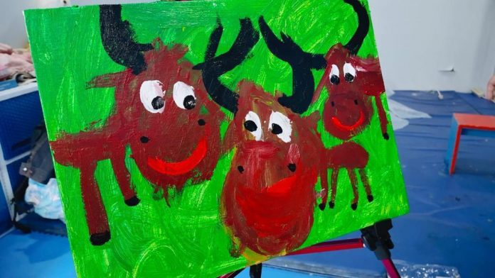 Autistic girl sells art works for underprivileged families