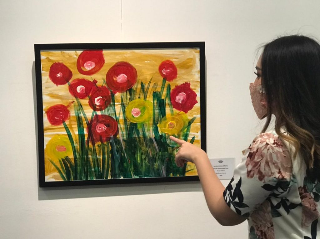 Autistic girl raises funds from painting exhibition for underprivileged families