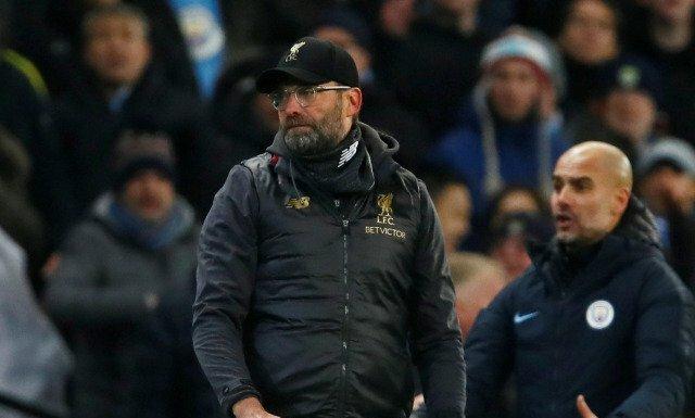 Arsip - Reaksi manajer Liverpool Juergen Klopp (kiri) dan manajer Manchester City Pep Guardiola dalam pertemuan terakhir mereka di Liga Inggris 2018/19 di Stadion Etihad, Manchester, Inggris, (3/01/ 2019)