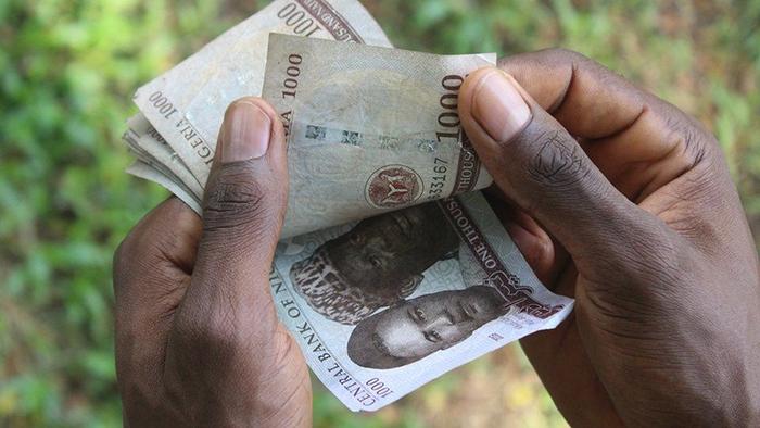 Đồng naira mất giá khiến nhiều người Nigeria tìm sang Bitcoin để giữ tiền. Ảnh: Getty Images.